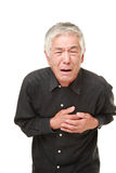 Senior Japanese man heart attack Stock Photos
