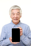 Senior Japanese man holding a Tablet PC Royalty Free Stock Image