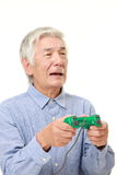 Senior Japanese man losing playing video game Royalty Free Stock Photo