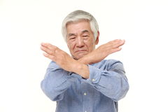 Senior Japanese man making NO gesture Stock Photos