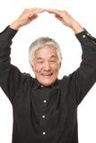 Senior Japanese man making OK gesture Stock Photos