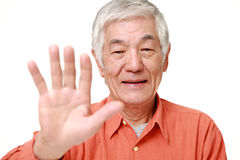 Senior Japanese man making stop gesture Royalty Free Stock Images