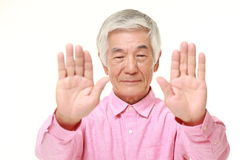 Senior Japanese man making stop gesture Royalty Free Stock Image