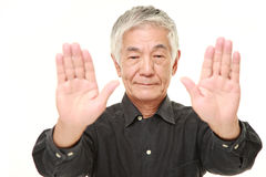 Senior Japanese man making stop gesture Stock Photos