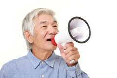 Senior Japanese man with megaphone. Studio shot of senior Japanese man on white background Stock Image