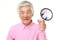 Senior Japanese man with megaphone. Studio shot of senior Japanese man on white background Stock Photos