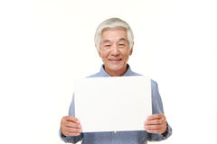 Senior Japanese man with message board Royalty Free Stock Image