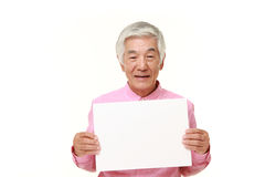 Senior Japanese man with message board royalty free stock photography