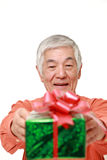 Senior Japanese man offering a gift Stock Image