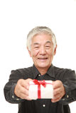 Senior Japanese man offering a gift Stock Photography