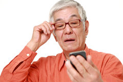 Senior Japanese man with presbyopia Stock Photography