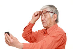 Senior Japanese man with presbyopia Royalty Free Stock Photos
