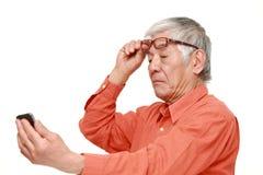 Senior Japanese man with presbyopia Royalty Free Stock Photos