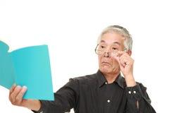 Senior Japanese man with presbyopia Stock Photography