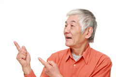 Senior Japanese man presenting and showing something Royalty Free Stock Images
