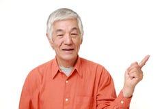 Senior Japanese man presenting and showing something Stock Images