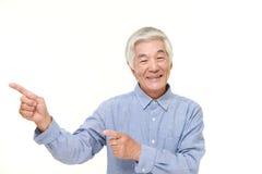 Senior Japanese man presenting and showing something Stock Photos