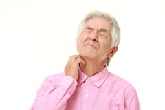 Senior Japanese man scratching his neck Royalty Free Stock Images