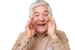 Senior Japanese man shout something. Portrait of senior Japanese man shout something  on white background Stock Photography