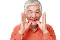 Senior Japanese man shout something. Portrait of senior Japanese man on white background Stock Images