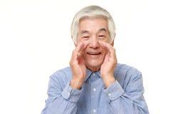 Senior Japanese man shout something. Studio shot of senior Japanese man on white background Royalty Free Stock Photography