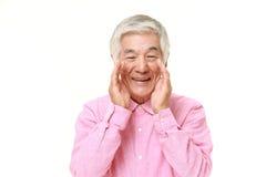 Senior Japanese man shout something. Studio shot of senior Japanese man on white background Stock Photos