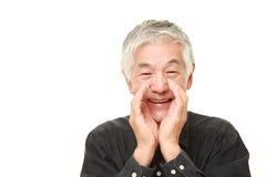 Senior Japanese man shout something. Studio shot of senior Japanese man on white background Royalty Free Stock Photo