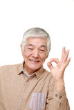 Senior Japanese man showing perfect sign Royalty Free Stock Images