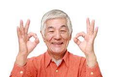 Senior Japanese man showing perfect sign Royalty Free Stock Photo