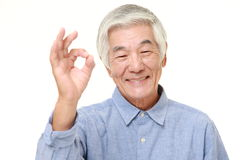 Senior Japanese man showing perfect sign Stock Photo