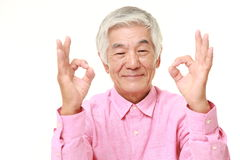 Senior Japanese man showing perfect sign Stock Images