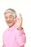 Senior Japanese man showing perfect sign Royalty Free Stock Image