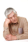 Senior Japanese man sleeping on the table Stock Photo