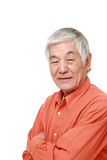Senior Japanese man smiles Stock Photo