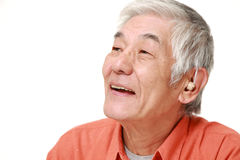 Senior Japanese man smiles Royalty Free Stock Photography