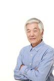 Senior Japanese man smiles Stock Images