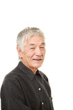 Senior Japanese man smiles Royalty Free Stock Images
