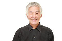 Senior Japanese man smiles Stock Images