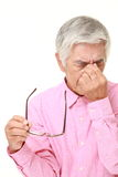 Senior Japanese man suffers from Asthenopia Stock Images