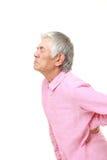Senior Japanese man suffers from lumbago. Studio shot of senior Japanese man on white background Royalty Free Stock Image