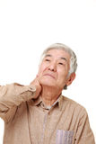 Senior Japanese man suffers from neck ache Royalty Free Stock Photos