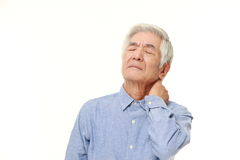 Senior Japanese man suffers from neck ache stock photos