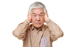 Senior Japanese man suffers from noise Stock Image