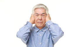 Senior Japanese man suffers from noise Royalty Free Stock Image