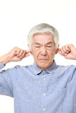 Senior Japanese man suffers from noise Royalty Free Stock Images