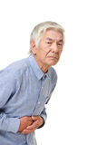 Senior Japanese man suffers from stomachache Stock Photos
