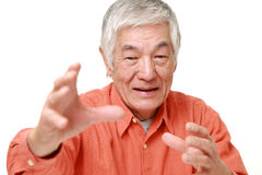 Senior Japanese man with supernatural power Stock Image