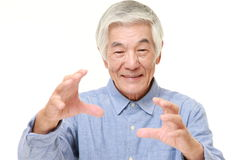 Senior Japanese man with supernatural power Stock Photo