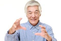Senior Japanese man with supernatural power Stock Photo