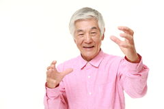 Senior Japanese man with supernatural power Stock Image